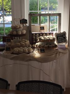 wedding cake and cupcake spread